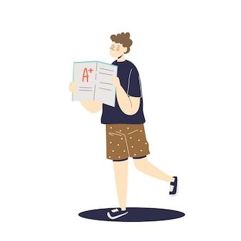 Мальчик держит школьную контрольную работу с высокой оценкой