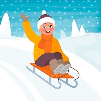 Boy is riding a sleigh from a hill