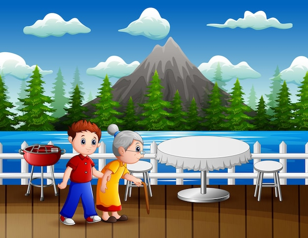 A boy lead his grandmother walking in a restaurant