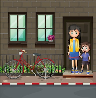 Boy and mother in front of a house