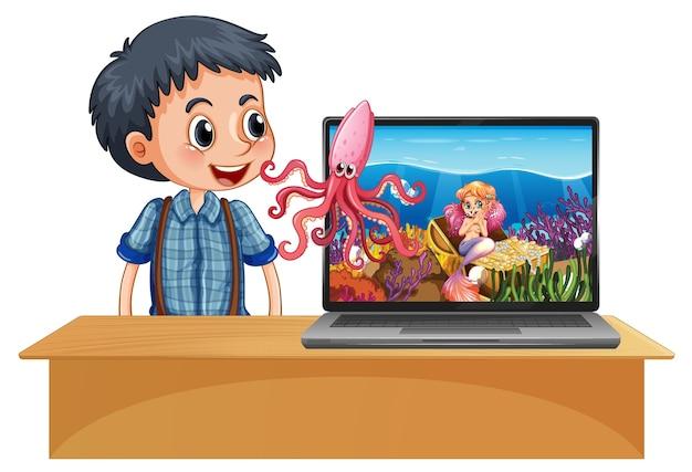 スペーステーマのデスクトップの背景を持つテーブルでノートパソコンの横にある少年