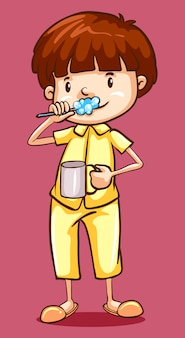 Boy in pajamas brushing teeth