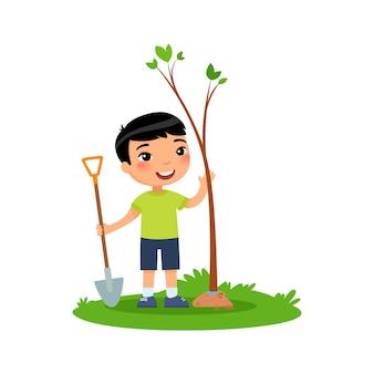 白で隔離の木を植える少年