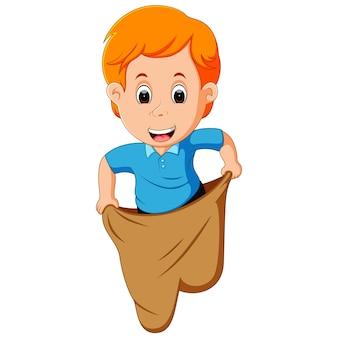 Boy playing jumping sack race