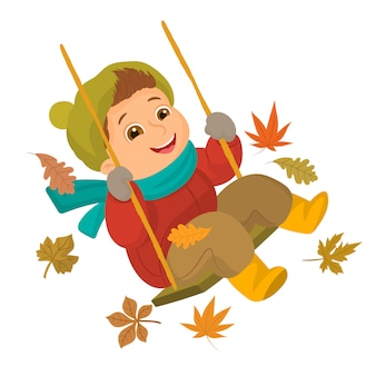 Boy playing on a swing in autumn season