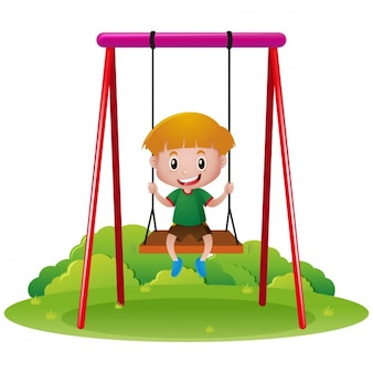 Boy playing in a swing