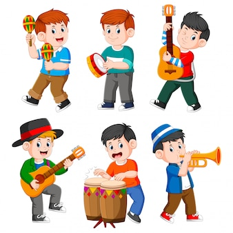 Boy playing with different musical instruments