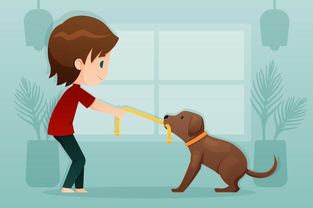 彼の犬と遊ぶ少年