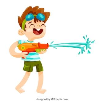 Ragazzo che gioca con la pistola ad acqua