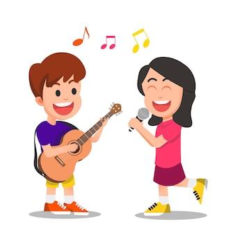 Мальчик играет на гитаре, а маленькая девочка поет