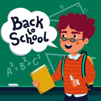 Boy pupil in front of blackboard with back to school text