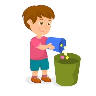 Boy putting garbage into trash bin