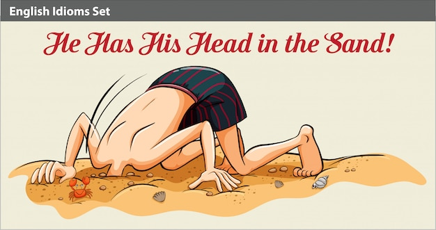 A boy putting his head in the sand
