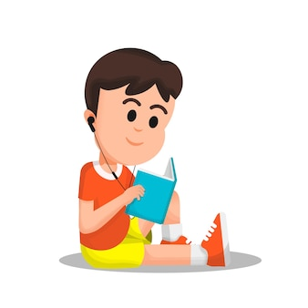 A boy reading a book with a headset in his ear