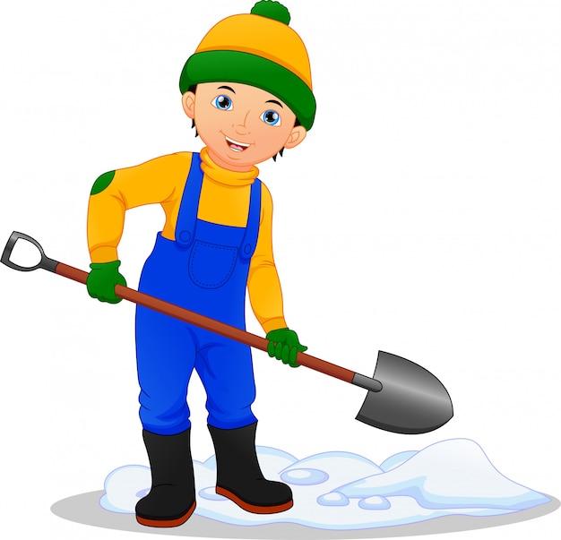 シャベルで雪を取り除いた少年