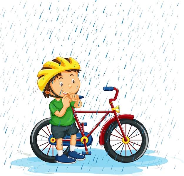 Мальчик катается на велосипеде в дождь