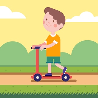 Boy riding a kick scooter on park road