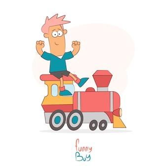 Boy riding a toy train
