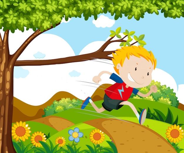 公園で走っている少年