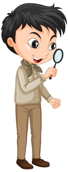 Boy in safari outfit holding magnifying glass