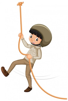 Boy in scout uniform climbing rope on white background