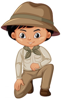 Boy in scout uniform on white