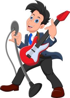흰색 배경에 고립 된 기타를 들고 노래하는 소년
