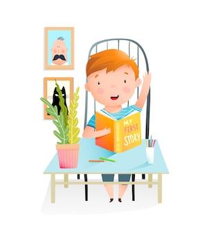 勉強中の本を読んで教室の机に座っている少年