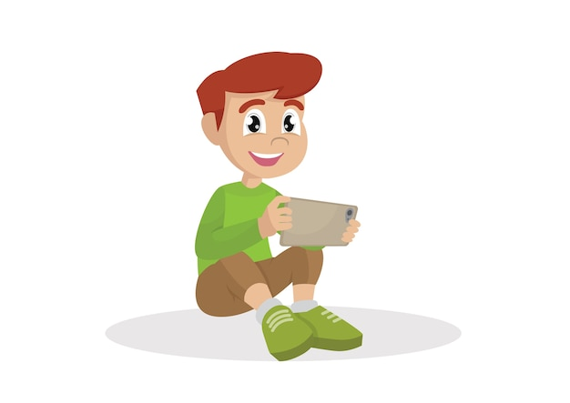 Boy sitting on the floor with a tablet computer in hands.