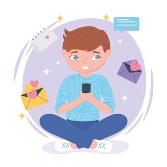 チャットにスマートフォンを使用して座っている少年