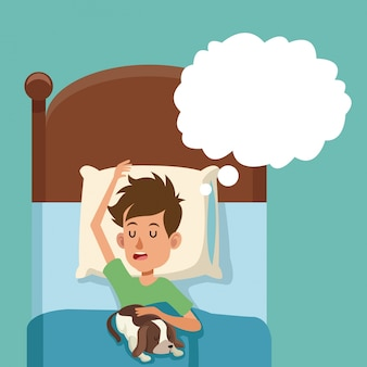Мальчик спит сон с собакой в постели