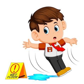 Boy slipping on wet floor