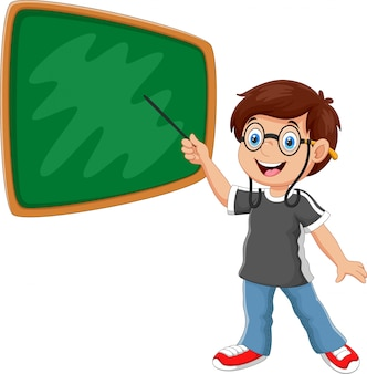 A boy stands in front of the blackboard with a pointer