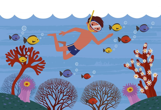 A boy swimming in clean sea with healthy fish and coral around