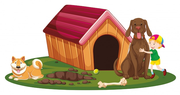 Boy and two dogs by the doghouse