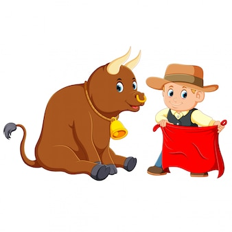 The boy uses the brown hat holding the red flag