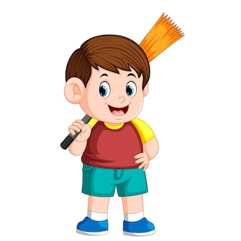 Boy using the red clotheis holding the broom for cleaning the trash