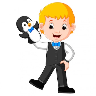The boy was using penguin puppet with blue bow tie