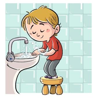 石鹸で手を洗う少年