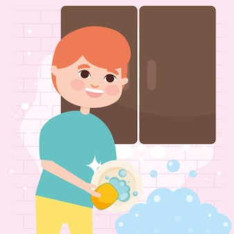 台所で皿を洗う少年