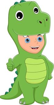Boy wearing dinosaur costume thumbs up