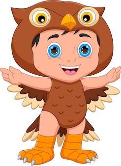 Boy wearing owl costume waving