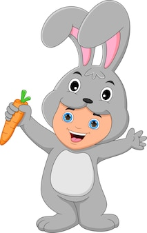 Boy wearing rabbit costume holding a carrot