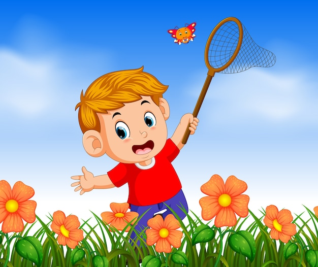 Boy wearing red shirt catching butterflyin the jungle