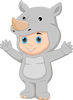 Boy wearing rhino costume waving