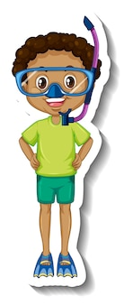 Un ragazzo che indossa l'adesivo del personaggio dei cartoni animati con maschera da snorkeling