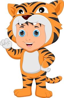 Boy wearing tiger costume waving