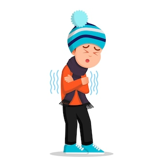 A boy in winter clothes feels cold