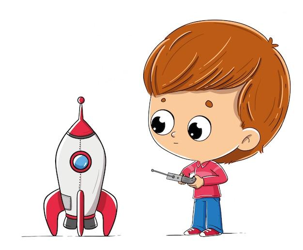 おもちゃのロケットを持つ少年