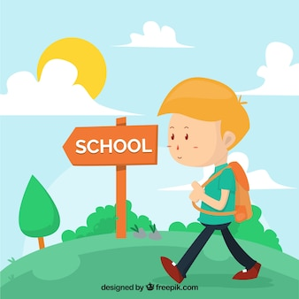 Boy with backpack walking to the school